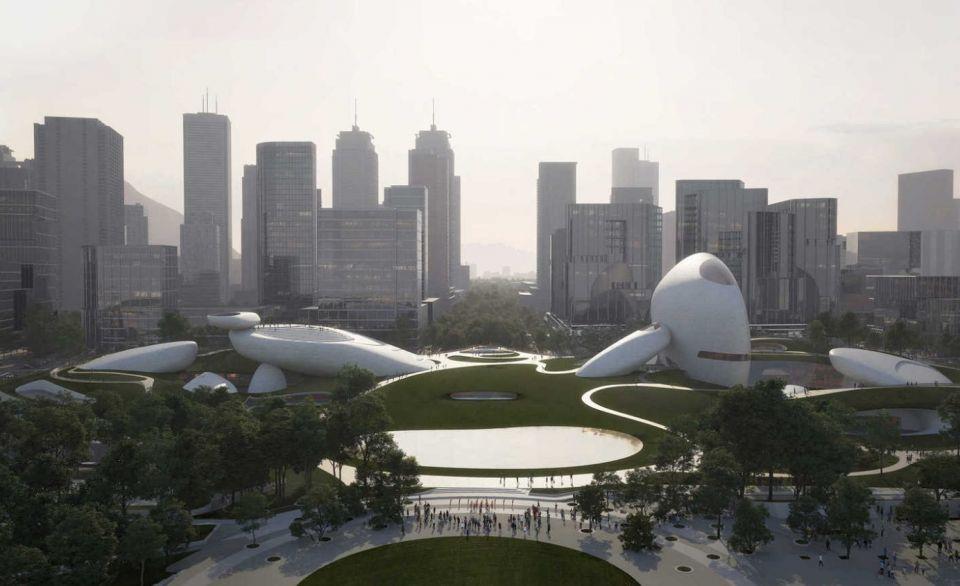 Внеземная архитектура MAD Architects для набережной в Шэньчжэне, КитайПока это только визуализация, но исходя из реализаций предыдущих проектов MAD, можно предположить, что финальный результат будет не хуже. Проект нового культурного комплекса площадью 51000 квадратных метров, который включает в себя зал креативного дизайна, музей науки и техники и множество других культурных и спортивных разделов, планируется реализовать в районе парка на городской набережной Шеньчженя. Генплан парка площадью 18,2 гектара также разработан MAD.По мнению руководителя бюро, Ма Янсонга, архитектура должна быть интегрирована в природу и формировать ландшафт, одухотворяющий современные города. В этом проекте архитекторы попытались создать атмосферу некоего сюрреализма, запечатлев гигантские валуны, разбросанные между небоскребами мегаполиса с одной стороны и залива Шеньчженя с другой. Выставочные павильоны, стилизованные под огромные каменные изваяния будут венчать подземную часть комплекса и окружать утопленные в планировке амфитеатры. Сам комплекс будет являться неотъемлемой частью парка, а его элементы будут соединены прогулочными дорожками. Со всех смотровых площадок, расположенных в верхних частях высоких валунов, будет открываться незабываемый вид на залив.#общественныездания #китай