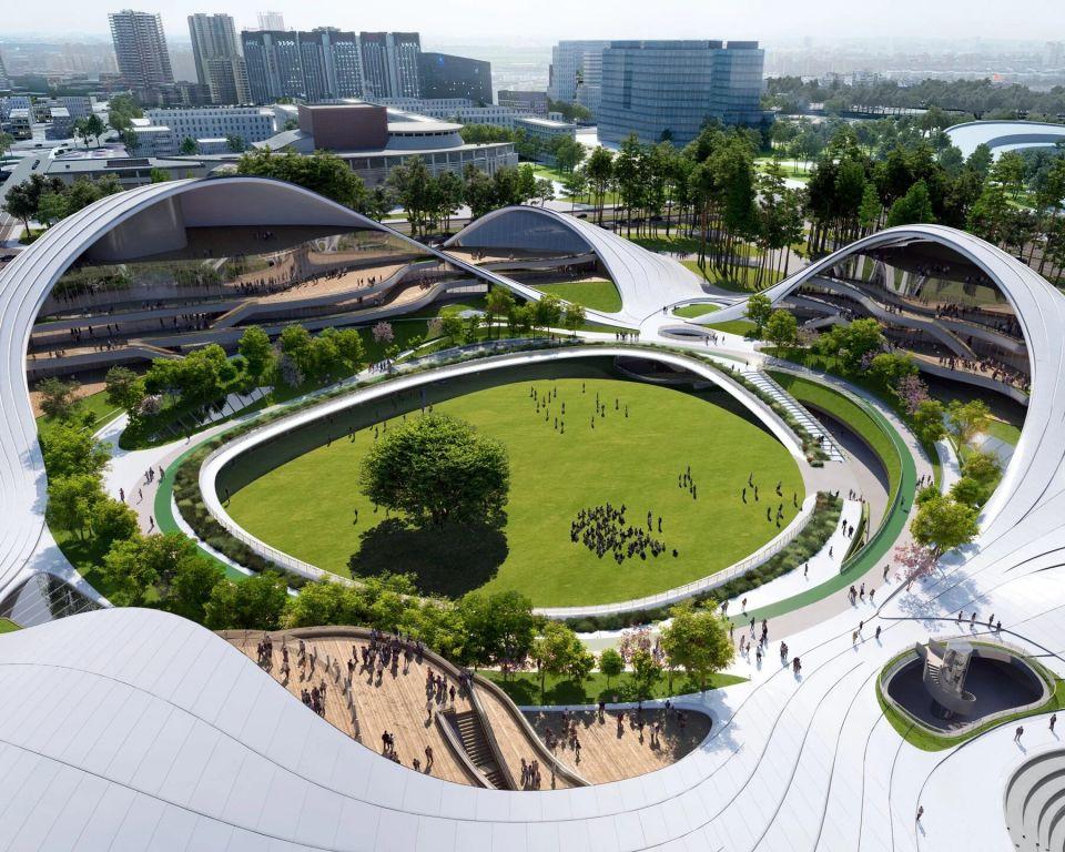 В Китае реализуют масштабный проект в стиле органической архитектурыMAD architects представили визуализации проекта гражданского центра в Цзясине (Китай). На площади 130 тысяч квадратных метров расположатся три объекта, связанные в единый комплекс: центр молодежи, центр активного отдыха для женщин и детей и музей науки и техники.Комплекс зданий будет будет представлять собой не просто объекты соответствующего функционального назначения, но и художественное образование, в котором сольются воедино архитектурная форма и окружающий ландшафт. В центре комплекса расположена огромная зеленая зона, откуда будет организован доступ в каждое из трех зданий.Комплекс будет располагаться на берегу озера. Планируется, что бОльшая часть деревьев, расположенных на месте строительства, будет сохранена и станет важной частью парка.Завершение строительства ожидается в 2023 году.#общественныездания #китай